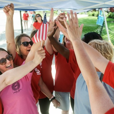 From left nurses Barb Mazur, Cortnee Cowell, Brooke Peters, and several others celebrate a possible end to their strike against Mercy Health Wednesday, June 12, 2019, in front of St. Vincent Medical Center in Toledo, Ohio. THE BLADE/JEREMY WADSWORTH