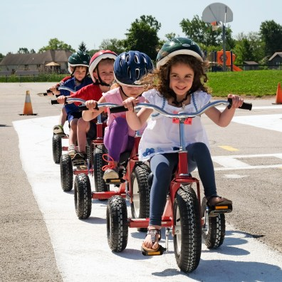 Ruby Freed leads a group of riders on their trikes during Safety Town. Sylvania Township Police hosts Safety Township for pre-kindergarten children at Central Trail Elementary School in Sylvania, Ohio on June11, 2019. Young kids learn traffic safety, bicycle safety, fire/ems safety, electric/water safety and a host of other things. The Blade/Jetta Fraser
