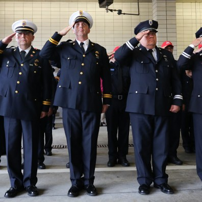 Firefighters salute during the annual Toledo Fire & Rescue Department Memorial Service Monday, June 10, 2019 in Toledo. The service was held inside Fire Station Number 1, the Michael P. Bell Administrative Building. BLADE/DAVE ZAPOTOSKY