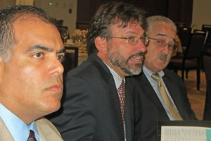 Economist Vicente Feliciano (center) discusses the results of MIDA's latest industry study.
