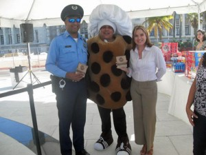 "Julio Navedo, center, has been performing as the hotel's ""Doubletree cookie"" character, participating in numerous activities related to the hotel and the community. To the right is San Juan Mayor-elect Carmen Yulín Cruz."