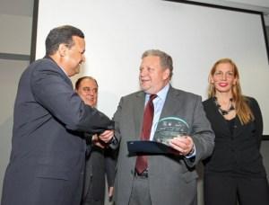 Caguas Mayor William Miranda-Torres, bestows a recognition to Luis García-Feliú, veteran member of the Inova advisory board, as Inteco President Oscar Jiménez, and Zamia Baerga, Caguas Economic Development Secretary look on.