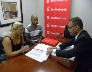 Scotiabank's mortgage officials closed on three no-interest loans in partnership with Habitat for Humanity.