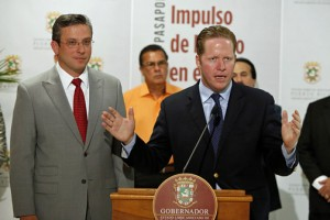 Secretary of State David Bernier (at podium) offers details of the new passport office, while Gov. Alejandro García-Padilla, on hand for the re-opening, listens.