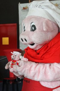 "A life-sized ""Wilbur the Mascot"" holds a stuffed-animal version of himself."