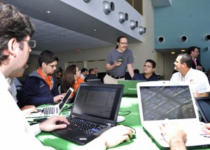 """Twitter co-founder Evan Henshaw-Plath speaks to some of the """"hackers"""" that participated in the Tech Summit."""