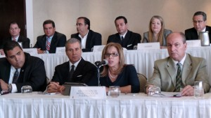 PRMA President Waleska Rivera offers details of what the private sector wants to discuss with the governor. She is flanked by representatives from 25 trade groups.