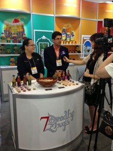 Puerto Rico Trade and Commerce Executive Director Francisco Chévere is interviewed at one of the booths.