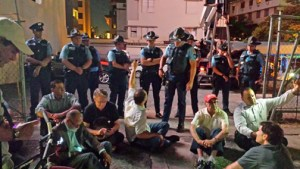 In an act of unity and solidarity, the group sat down on the sidewalk and refused to allow the truck to exit the property with the materials until an agreement is reached.