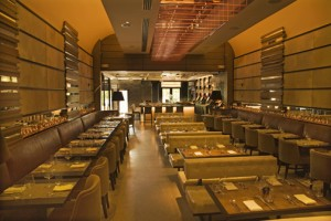 The Meat Market in San Juan seats 165 people throughout its dining room, lounges and bar area, which are wrapped in warm woods and gleaming metals, giving it a more glamorous take on the traditional steakhouse. (Credit: Lyall Aston)