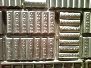 A total of 451 antique metal chocolate molds used by the company at one time create a stunning visual display on one of the walls at the ChocoBar.