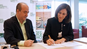 PRTEC Executive Director Nelson Perea and Tourism Co. Executive Director Ingrid Rivera-Rocafort sign the collaborative agreement.