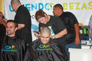 """The staff of technology firm Nagnoi recently joined the """"Uniendo Cabezas por los Niños del CAP,"""" shaving their heads for charity. The goal was to help the organization exceed its goal of raising $50,000 for pediatric cancer patients."""