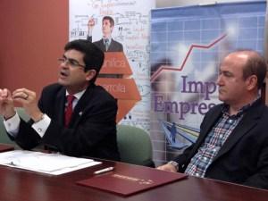 PR Trade Executive Director Francisco Chévere and PRTEC Executive Director Nelson Perea participate in a news conference Wednesday.