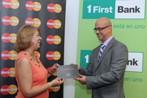 Dolores Santana receives her grand prize from Michael Weiss, vice president of FirstBank credit card services.