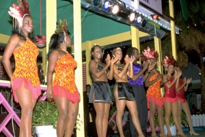 Colorful dancers entertain tourists at Port Lucaya Marketplace, Bahamas. (Credit: Larry Luxner)