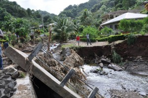 Part of a bridge is washed away in St. Vincent following Dec. 24 torrential rains. (Credit: Larry Luxner)