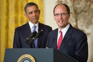 At podium, U.S. Secretary of Labor Thomas E. Pérez, flanked by President Barack Obama.