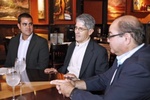 From left: Restaurants Operators Inc. executives Alex Lignos and Dionisio Trigo, and Miguel González vice president of operations of San Patricio Plaza, where one of the new LongHorn Restaurants opened.