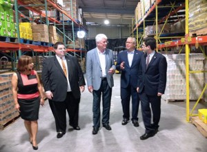 From left: Betsy Franceschini and Juan Eugenio Hernández-Mayoral of the Puerto Rico Federal Affairs Administration; Vicente Sánchez, president of Empresas Barsán and owner of the distribution center that opened in Orlando last week; Economic Development and Commerce Secretary Alberto Bacó; and Puerto Rico Trade Executive Director Francisco Chévere, during a walk-through of the center.