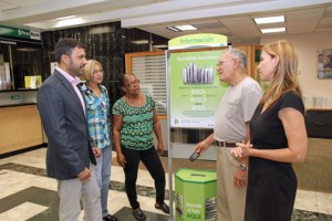From left: José M. Rivera, president of E-Cycling Puerto Rico, Inc.; Ana Pérez and Carmen Febres, of Martin Peña Recicla; René Nieves-Jiménez, a customer recycling a handset; and Carmen Pagán, FirstBank's senior vice president of compliance and community reinvestment .