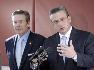From left: GDB Chairman David Chafey stands by Gov. García-Padilla during a recent news conference.