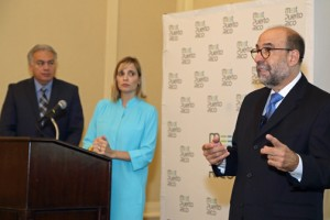 César Rey (right), board member of the Ricky Martin Foundation, discusses the problem of human trafficking, as Milton Segarra (left) and ?? (center) listen.