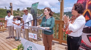 Last month, Tourism Chief Ingrid Rivera (at podium), flanked by Agriculture Secretary Myrna Comas, right, inaugurated Hacienda Tres Ángeles in Adjuntas.