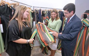 Designer Norma Domínguez shows pieces to Puerto Rico's First Lady Wilma Pastrana and Puerto Rico Trade and Export Executive Director Francisco Chévere during the store opening earlier this week.