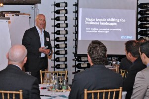 WorldNet President David Bogaty leads the gathering of business leaders.