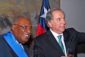 "Gérard Latortue, former prime minister of Haiti, receives the ""Orden de Merito"" award from Juan Gabriel Valdés, Chile's ambassador to the United States, at a Nov. 6 reception in Washington. (Credit: Larry Luxner)"