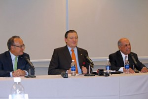 From left: FirstBank CEO Aurelio Alemán, Banco Popular President Richard Carrión and Financial Institutions Commissioner Rafael Blanco offer details of Friday's events during an early evening news conference. (Credit: Sin Comillas)