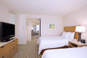 The suites feature new furniture with a calming driftwood stain, flooring, drapery, textiles and lighting.