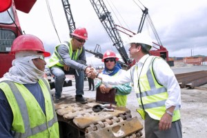 Gov. García-Padilla greets port workers during his visit to Sea Star Line's facilities in San Juan.