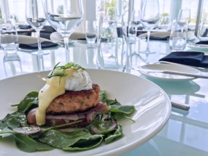 The Ottawa Salmon Cake Benedict, a jumbo salmon cake topped with local greens, poached egg, and creamy hollandaise, is part of the new brunch menu.