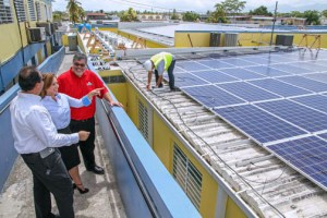 Presbyterian Academy and FirstBank officials inspect the solar panel installation.