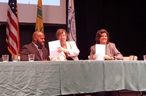 The coordinator of federal relations for the USVI, Shawn-Michael Malone, EPA Regional Director Judith Enck, and Department of Natural and Environmental Resources Secretary Carmen Guerrero, sign the MOU to address the effects of climate change.