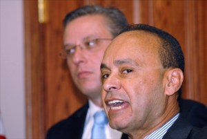 Rep. Luis Gutiérrez (D-Ill.) speaks during a news conference Wednesday called by Puerto Rico Gov. Alejandro García-Padilla (background.)