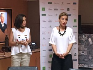 Lucienne Gigante, right, of AccessLatina, offers details of the first-round winners.