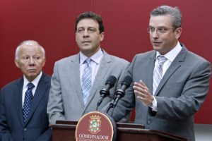 From left: Justice Secretary César Miranda and Secretary of State Víctor Suárez flank Gov. García-Padilla during a news conference Monday morning.