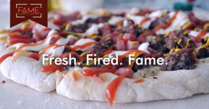 """The company's motto of """"You design it, we bake it!"""" offers clients a chance to customize their pizza."""