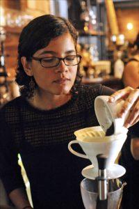 Professional barista Viviana Cruz prepares an espresso at Gustos Café in Guaynabo. (Credit: Larry Luxner)