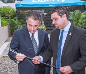 """Liberty Puerto Rico President Naji Khoury and Board President Javier Rúa-Jovet inspect cables during Tuesday's launch of """"ViaDIGITAL"""" in Santurce."""