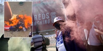 WATCH: Furious Manchester United fans burn US flag outside Old Trafford in protest against Glazers