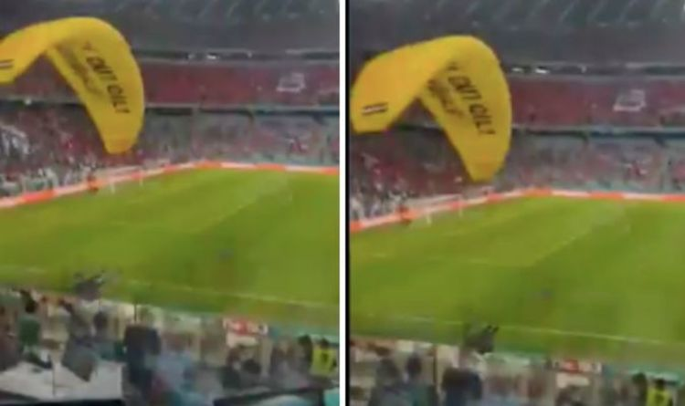 Protester nearly crashes into fans in scary near miss before France vs Germany
