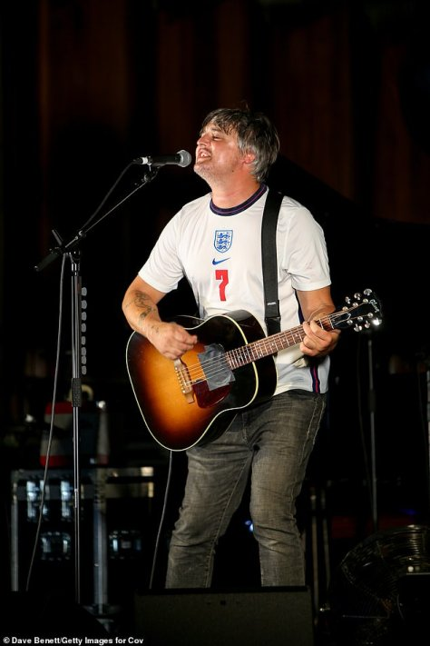 Casual look: The Babyshambles star donned a white England football T-shirt and dark grey jeans, which he teamed with a pair of white trainers