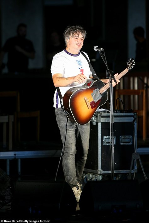 Performer: Pete appeared very happy with himself as he played his guitar to the crowds at the event