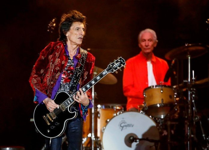 Ronnie Wood can't wait to play, and he's already recording with Mick Jagger and his former Face partners to warm up.  photo Kamil Krzyszynski / AFP