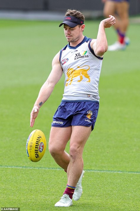 On the field: Her husband Lachie has been training with the Brisbane Lions for their match against the Melbourne Demons on Saturday