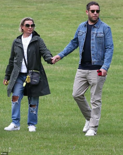 Cute couple: Lisa Armstrong looked besotted with boyfriend James Green as they headed out on a stroll together, the day after her ex Ant McPartlin tied the knot for a second time